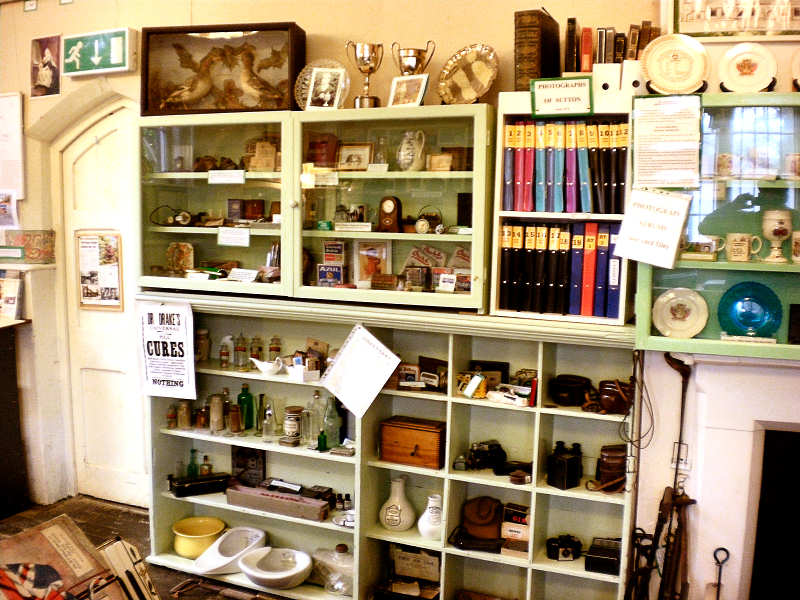 some of our display cases - note the 20+ photo albums of memories .. click to enlarge