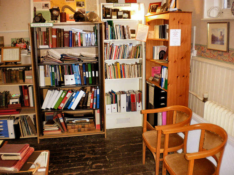 our Reference Library corner - two comfy chairs and a radiator! .. click to enlarge